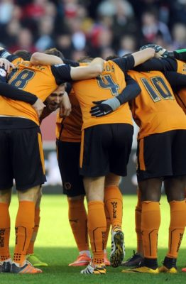 Wolverhampton-Wanderers-players-in-a-huddle-before-kick-off